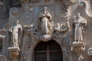 Statues of saints above front door to Mission San Jose church.