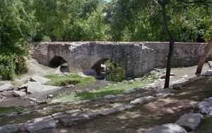 The double arched Espada aqueduct carries water in the acequia over Piedras Creek.