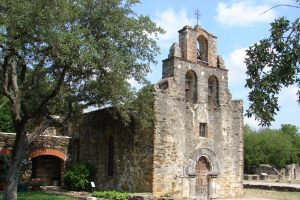 Front (east) and south facade of Mission Espada church.