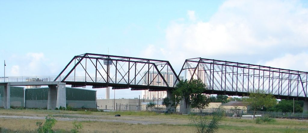 Looking southwest at the downtown skyline through the Hays Street Bridge.