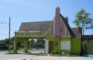 Side view of vacant Tudor-Revival style gas station at 901 Nogalitos.