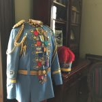 Traditional Fiesta coronation attire worn by King Antonio, including blue hat with red feathers.