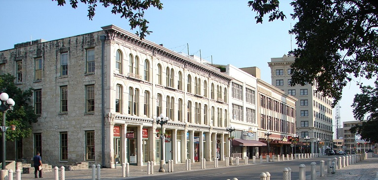 The historic buildings on the west side of Alamo Plaza: Crockett Block, Palace Theater, Woolwort Building