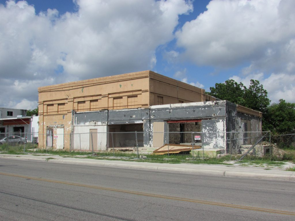 The former Crystal Ice Factory at 1603 S. Hackberry with metal cladding and stone veneer removed to show original 1928 building.