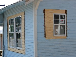 A house with original wood windows loses character with with vinyl replacements.