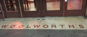 Woolworth's name spelled out on the floor in front of the Houston Street entrance