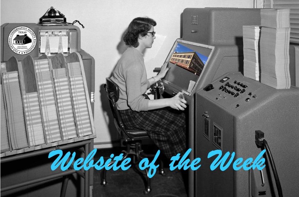 Woman sitting at 1950s computer