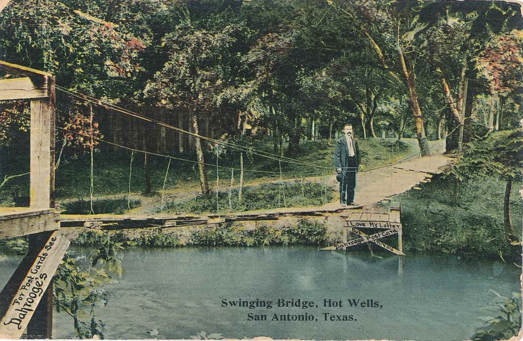 Postcard of a wooden bridge over the San Antonio Rivar at Hot Wells.