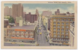 Color postcard looking west on Houston Street from Alamo Plaza. Woolworth Building on left.
