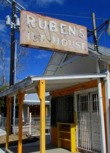 Front of Ruben's Ice House with sign at the corner of S. Colorado and El Paso Streets.