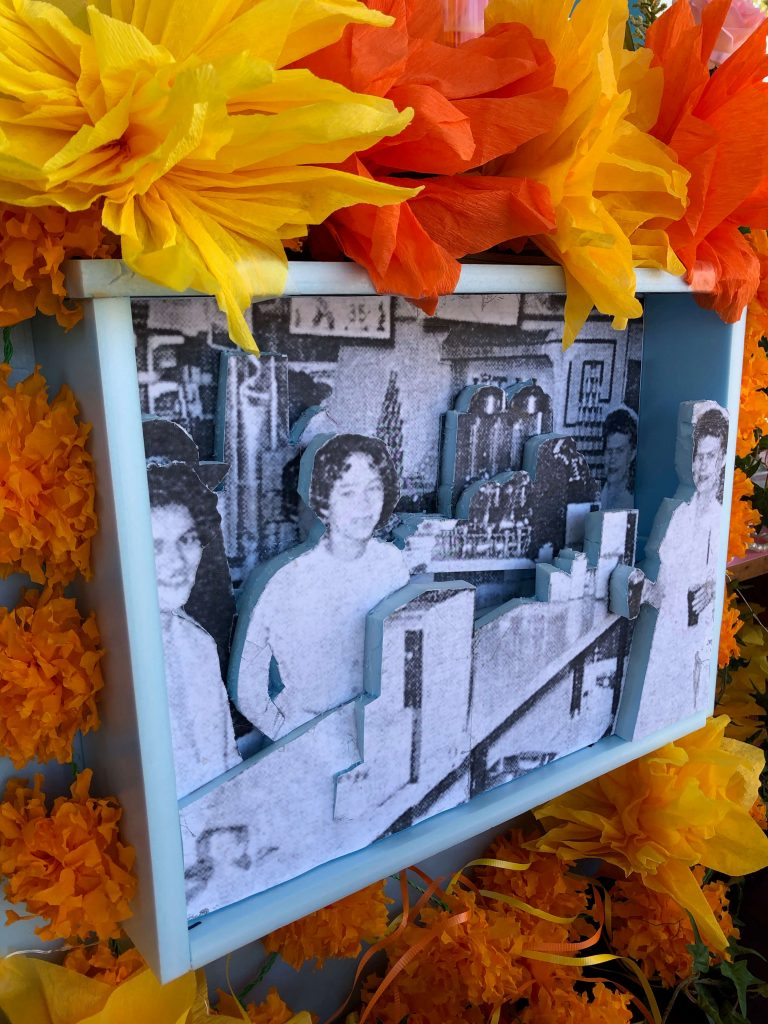 Center of the Mary Andrews ofrenda features a 3-D version of photo of her that appeared in JET magazine.