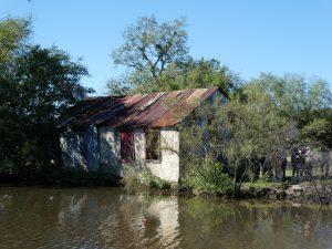 Beauregard Ranch building next to pond